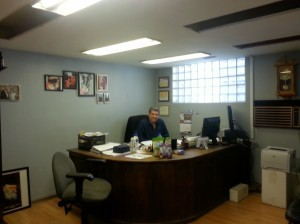Shalom, owner of Shalom and Son's. In his office on Anderson Street.