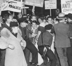 United Anti-Nazi Conference protesting, with the police restraining them.