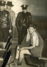 Rioting servicemen stripped some zoot suiters of their clothes in public. According to the Examiner's caption, this arrested teenager took the turn of events 'philosophically.' Courtesy of the Los Angeles Examiner Collection, USC Libraries.