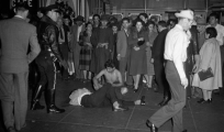 Zoot Suiter youth beaten and stripped naked.