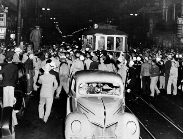 Zoot suit riot erupts in front of the Hippodrome Theater on Main Street, Downtown Los Angeles.