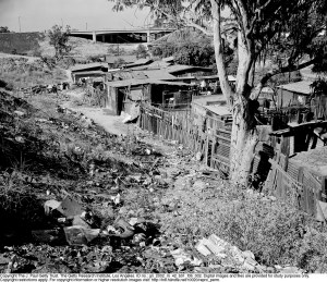 These were the living conditions of the Mexican families, living in the settlements of FIckett Hollow, Boyle Heights. (1950)