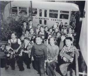 """Students arrive for after-school activities at the Eastside Jewish Community Center on Soto Street, c. 195-. Formerly the Soto-Michigan Jewish Community Center… sponsored integrated sporting leagues as well as programs designed to introduce cross-cultural understanding, In the 1950s, center director Joseph Esquith was removed because his policy of keeping the facilities available to anyone, regardless of politics, was considered subversive. (Los Angeles Daily News Photographic Archive, Department for Special Collections, Charles E. Young Research Library, UCLA)"""