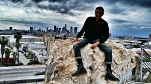 Sitting on one of the broken stumps of the art deco pillars that once graced the eastern end of the classic Sixth Street Bridge.