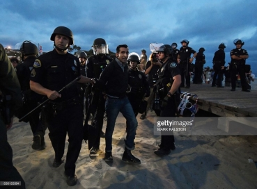 protester-is-arrested-after-the-america-first-pro-trump-group-clashed-picture-id836153394