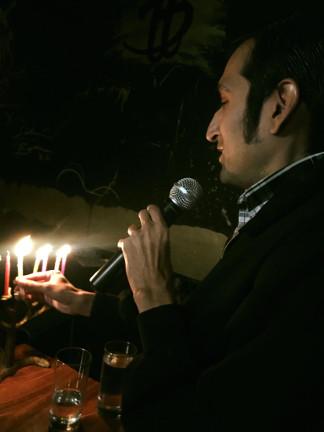 Shmuel Gonzales the Barrio Boychik, lighing the menorah in Hollywood